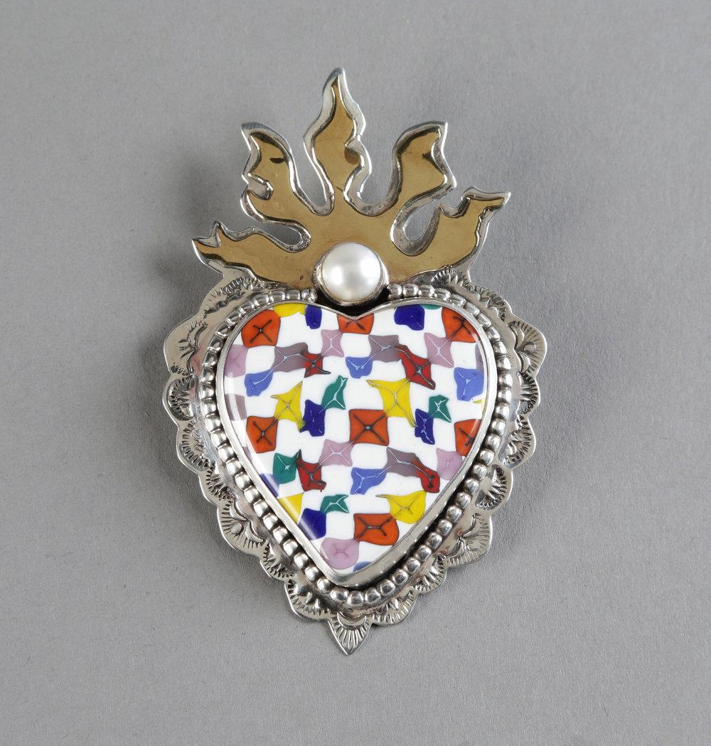 "Denise Barr  ""Murrine Heart,"" 2017  sterling, brass, murrain glass, cultured pearl  Langley, WA  3.33""x2.25""x.5""  $650"