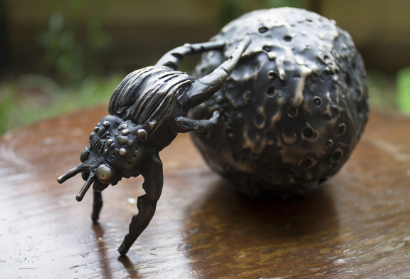 """Sarah Joy  """"Collector of the Cosmos,"""" 2015  bronze  Boynton Beach, FL  4""""x6""""x4""""  $4,500"""