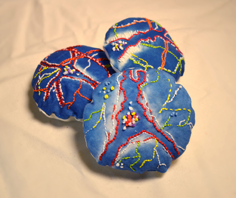"Lesley Nakonechny  ""Neural Pillows,"" 2016  cyanotype, embroidery, and fabric  Winnipeg, Manitoba  7""x7""x1""  $200"