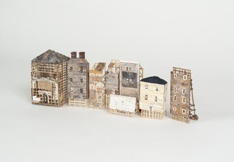 "Katie Steinberg  ""Facadism,"" 2016  chipboard, paper, basal wood, clay  Portland, OR  4""x10""x3""  $400"