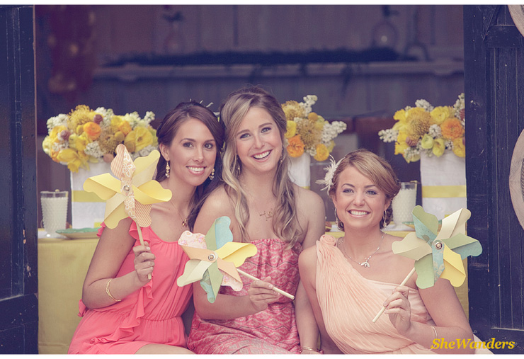 girls with color wheels in front of flowers, Shewanders Wedding Photography, San Diego Wedding Photography