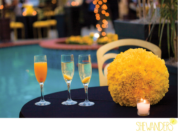 shewanders photography, yellow flowers, circle, flower arrangement, wine glasses, pool, nighttime