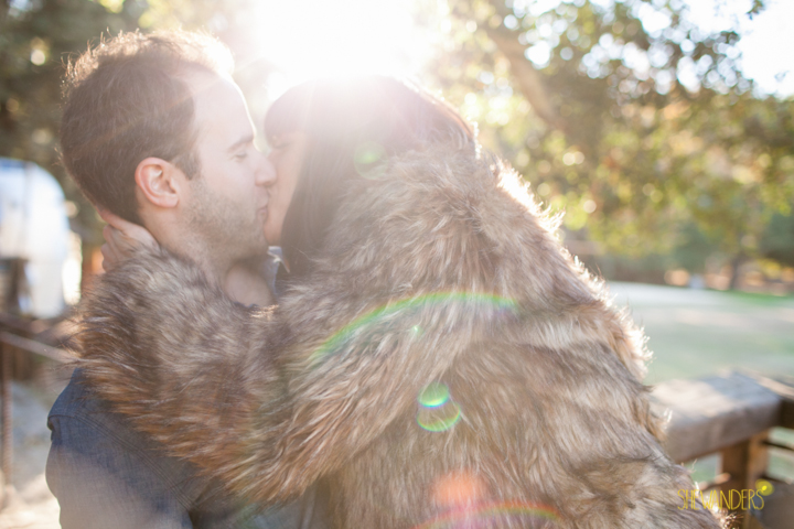 SheWanders Photography, kiss, fur, sun flare, couple