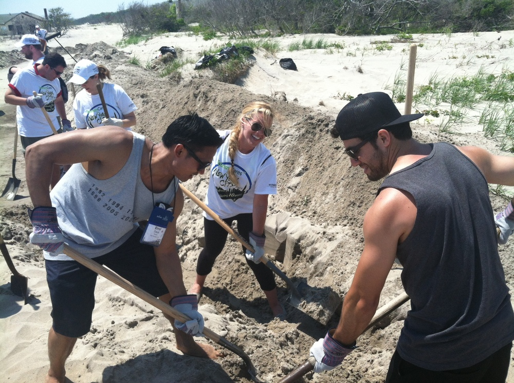 Travcoa volunteers digging at Jamaica Bay.jpg