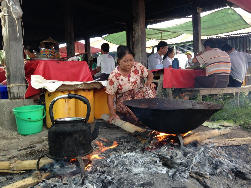 A village woman is preparing her station for the breakfast crowds.