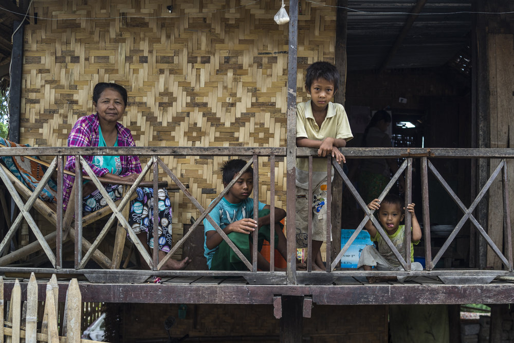 A family at their home in Nyaung Shwe.