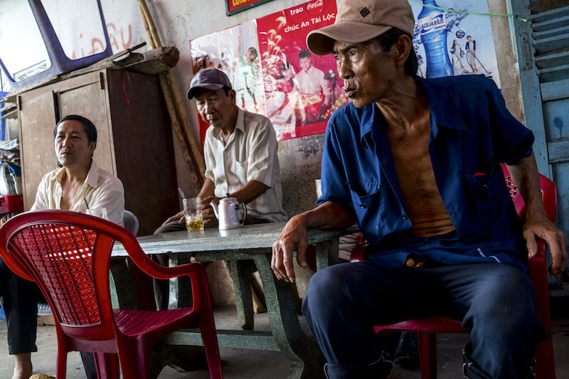 I sat down for coffee and tea (In Vietnam, tea is served with coffee) with farmers at a local's coffee house by the Mekong river in Vihn Long.