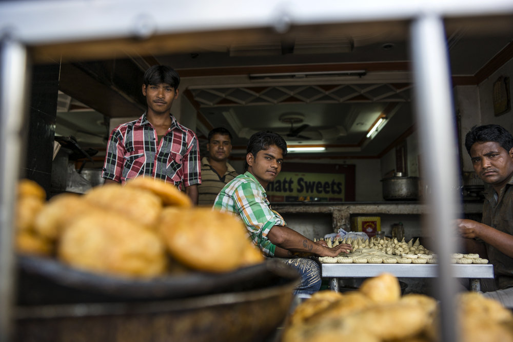 Young workers are making fresh samosas early in the morning before the rush at the market in Haridwar, Northern India.