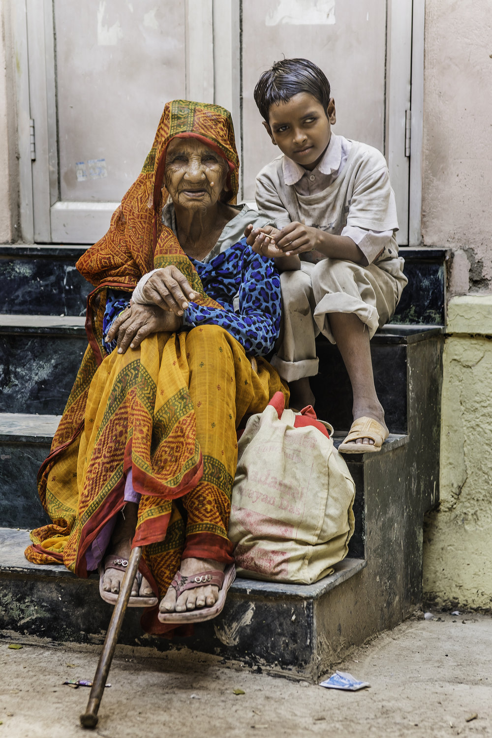 A grandma and her grandson have just sat down on their regular spot on a street in New Delhi.  They beg here all day.  I have managed to get them some rice and dal for lunch while I sat with them for a while.  They were grateful.