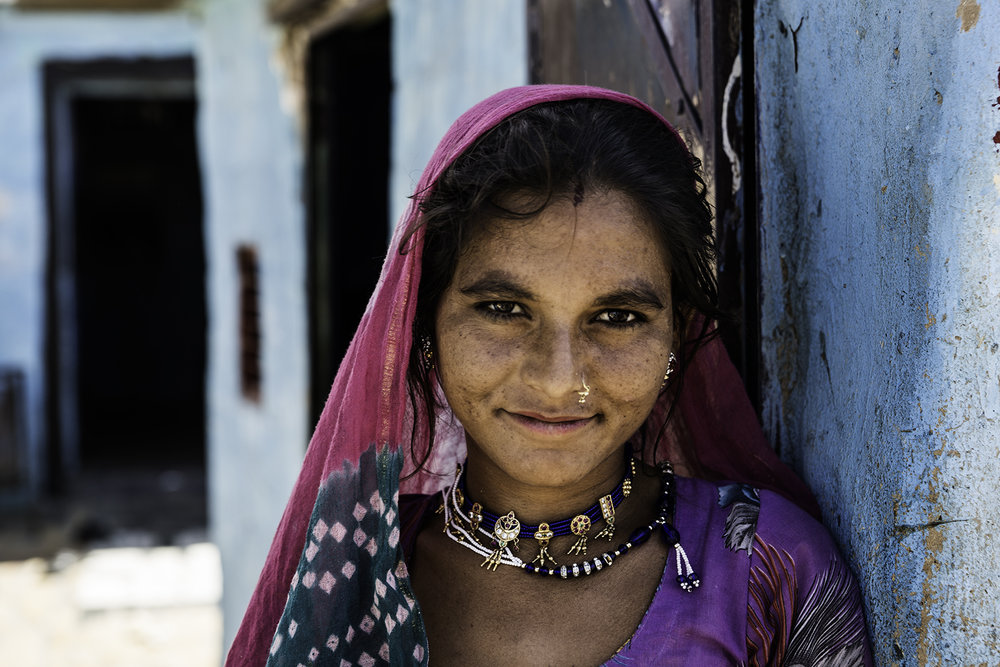A woman who live in a mud house outside the city of Jaisalmer.