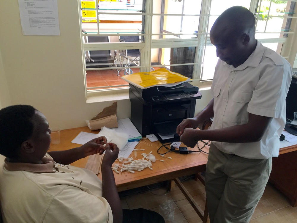 Two members of the Fluorspar staff prepare supplies for the cervical cancer screening.