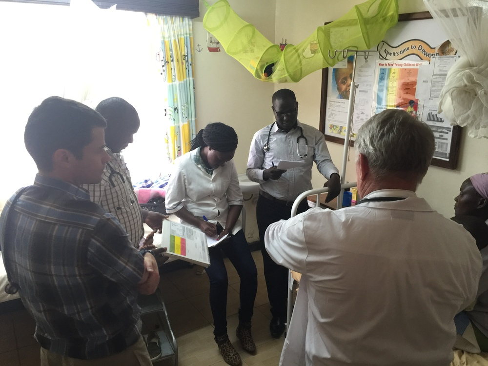 The Medcan Naweza team including Dr. Michael Hawkes and Dr. Ed Bekeris and meets with the team at the Field Marsham Health Clinic during rounds