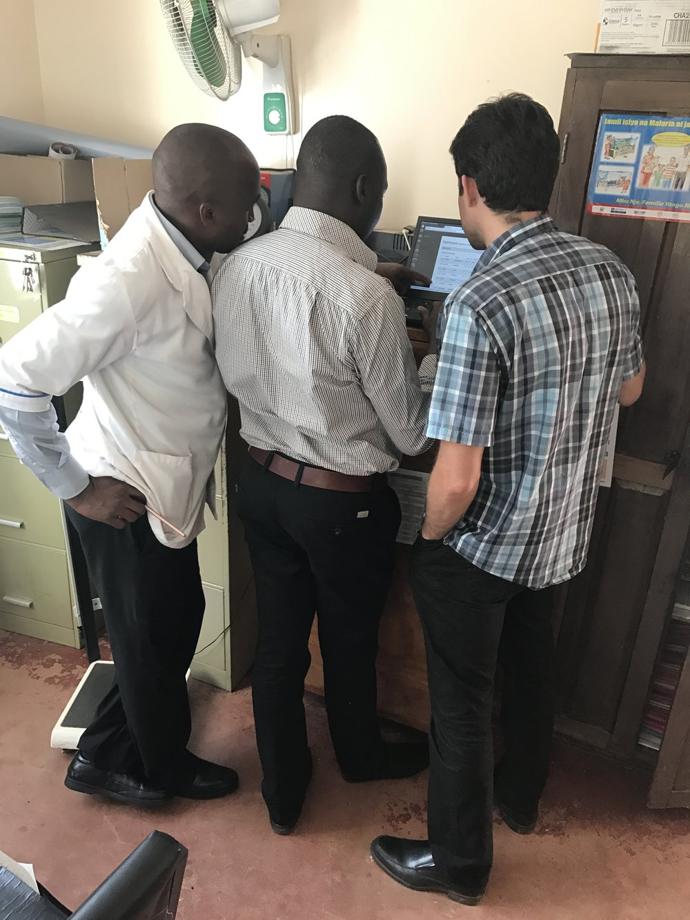 Reviewing the Chronic Disease data on the computer provided by Naweza. The Community Health Workers have screened over 3,000 people over the age of 40 to identify those at risk of a cardiovascular event in the next 10 years,