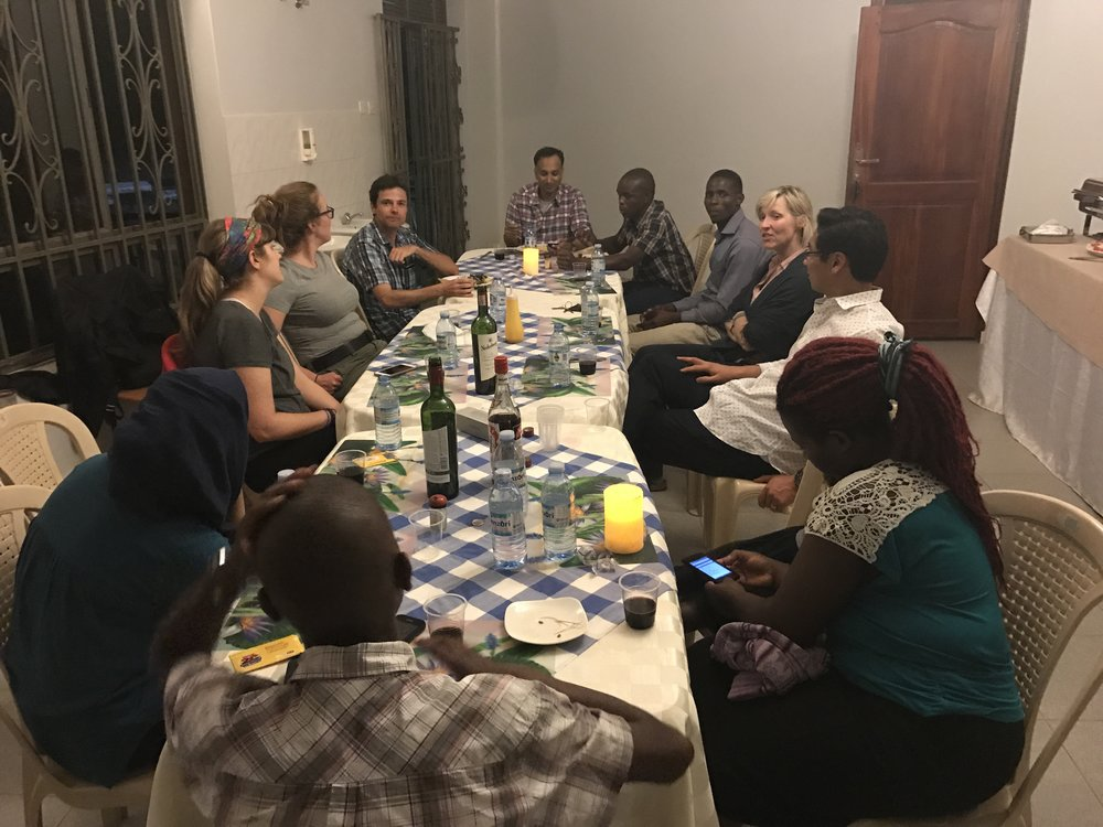 Enjoying our first dinner in Uganda with our new friends.