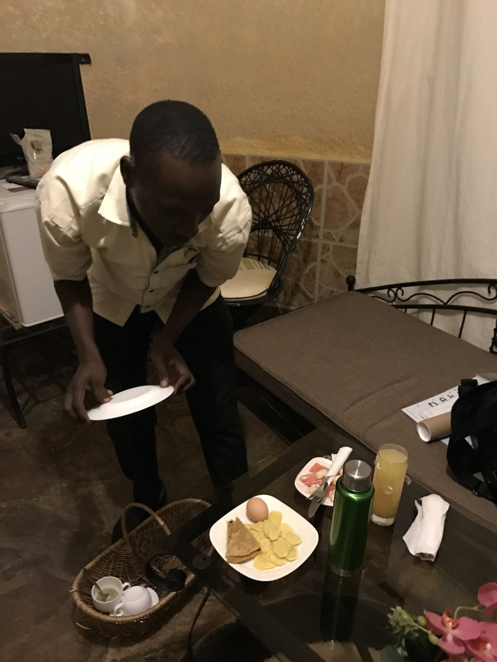Bruce, one of the staff at the hotel, surprises me with breakfast to my room. I had asked for tea and he brought me the full breakfast!