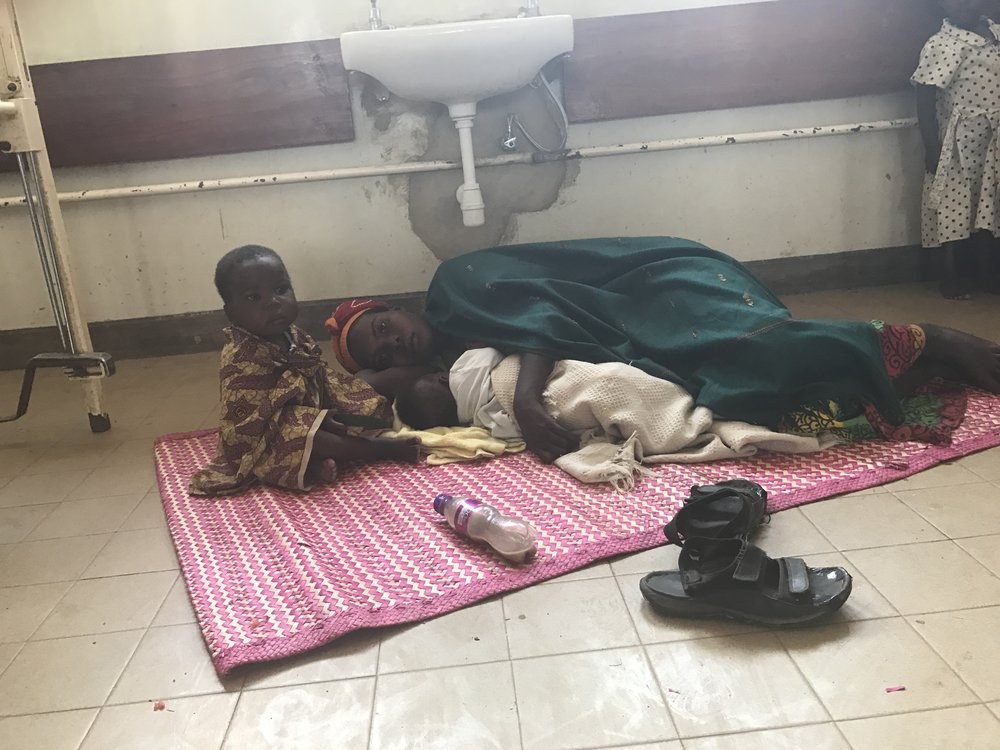 A tired mother with her sick child and newborn. I always ask if I can take these photos and all of the Ugandans are very gracious in allowing me to take pictures.