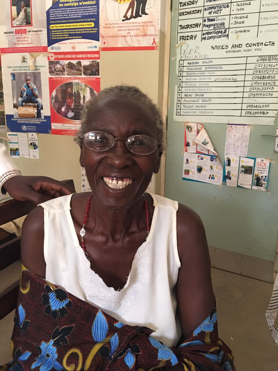 A happy vision clinic patient wearing her new glasses!