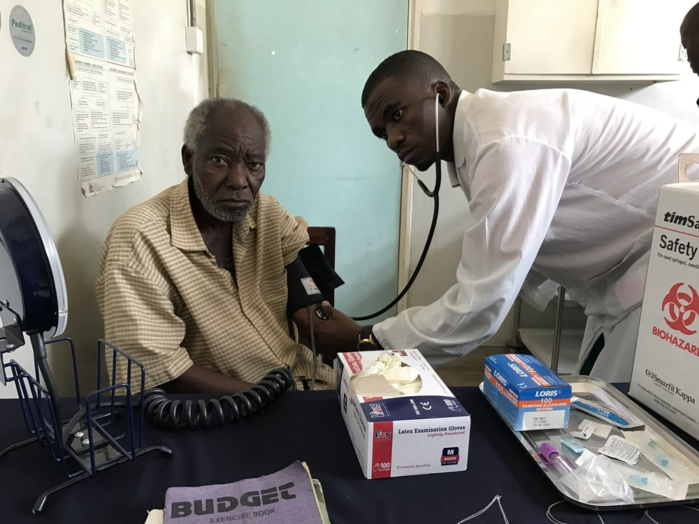 A chronic disease patient having his blood pressure taken.