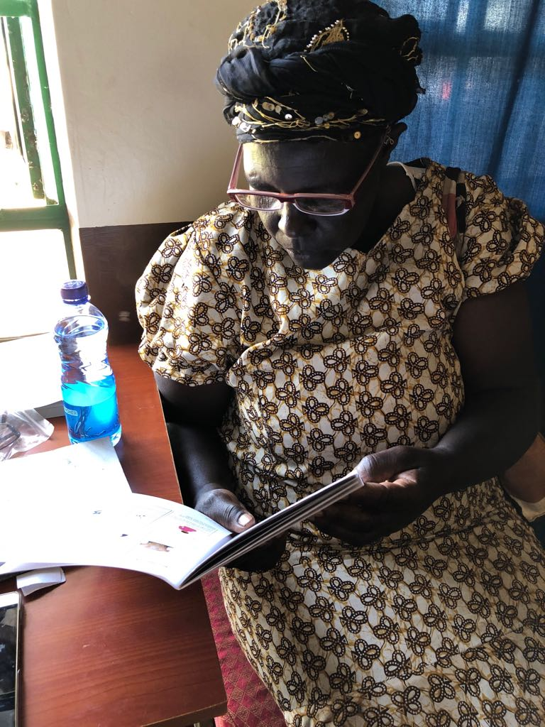 A patient tests out her new glasses to determine if her vision has improved. Naweza continued training on prescriptions for reading glasses and were able to give away 25 pairs this outreach.