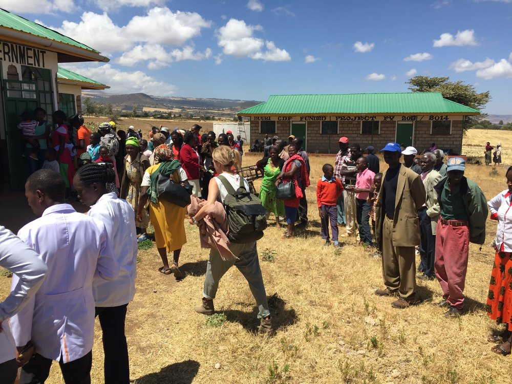 Stacy Francis and the Lewa nurses (at bottom left) upon arrival at the outreach location. Patients wait to be introduced to this outreach's clinicians