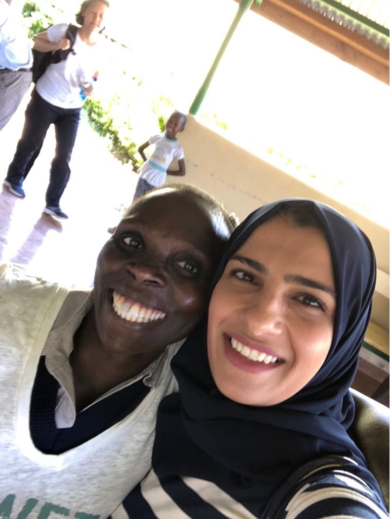 Rosaline - our translator and surveyor extraordinaire!- and Dr. Sidiqa - Dr Sue in the background and a smiling photo-bomber :)