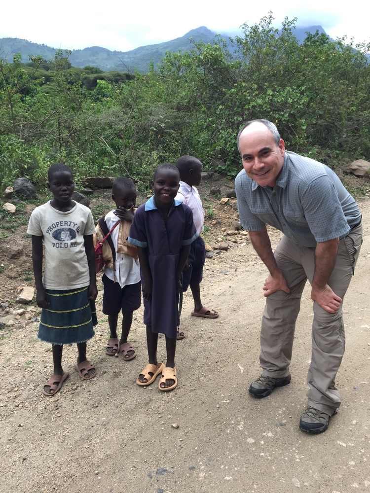 Dr. Paul Cohen, a dermatologist at Medcan, pictured here with local children during his first Naweza trip in July 2016. During the February 2018 trip, he supported Medcan Naweza from Toronto via the WhatsApp chat group we created.