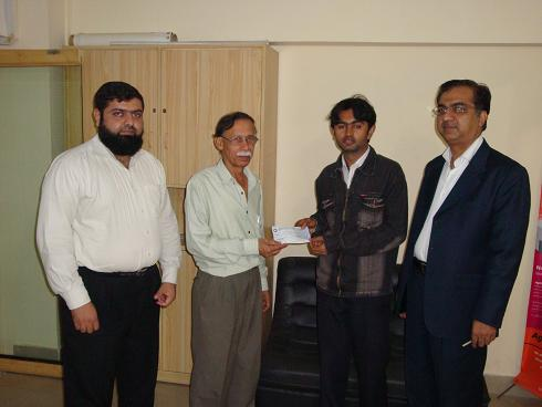 From left to right: Zeshan Ahmed, Koshish Foundation,  Professor Muhammad Nauman, NED University of Engineering & Technology,  Om Prakash, Scholarship Winner,  Jamal Rajput, Koshish Foundation.