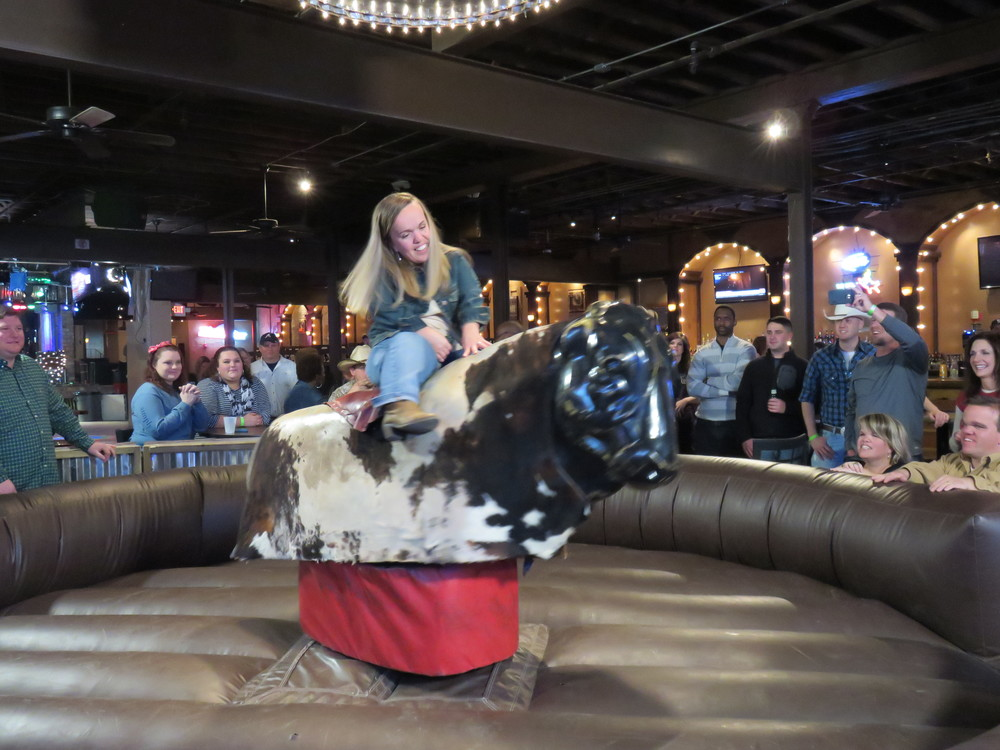 Amber attempting to ride the mechanical bull