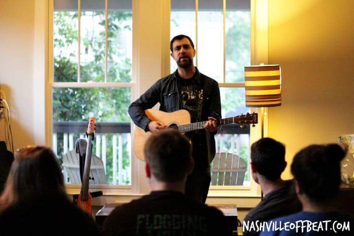 Josh Gray performing at house concert in Nashville