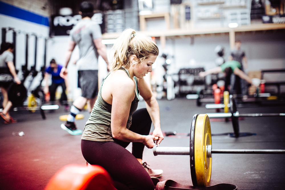 Clare D. loading up her barbell before the workout.