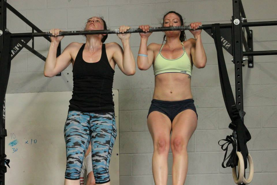 "Clare R. and Mary S. digging in on pull-ups during ""Murph"" - the marathon ""Cindy"""