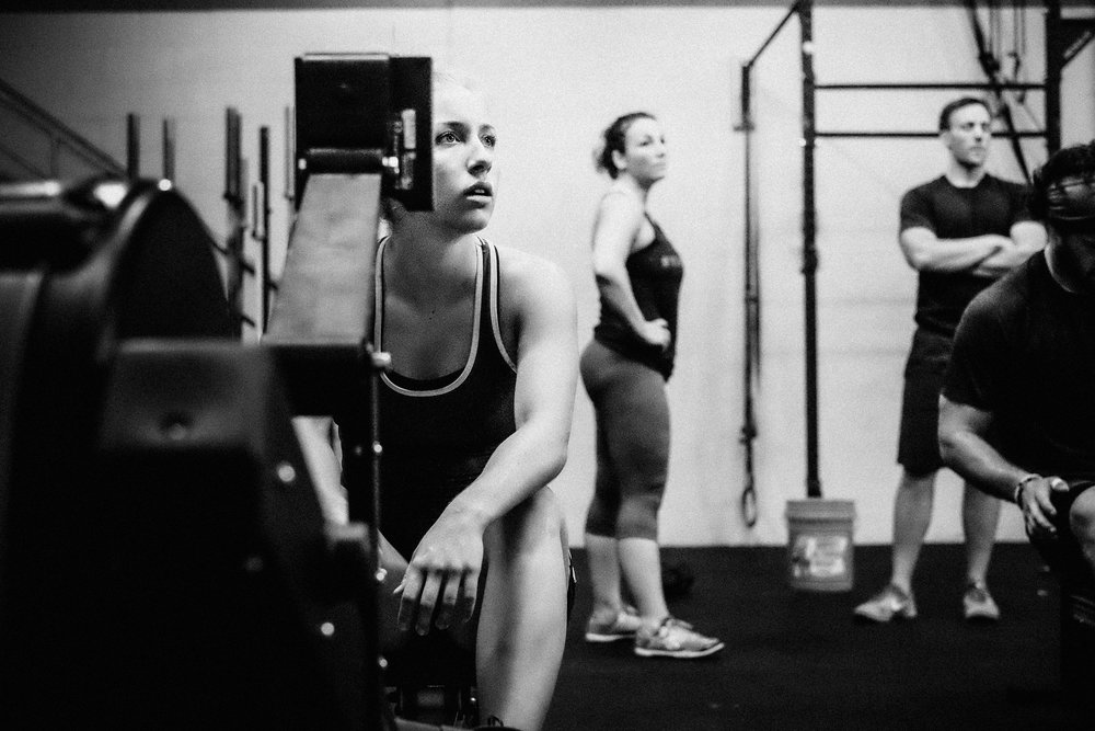 Brielle, Rachelle and Zach await last minute instructions before beginning their workout
