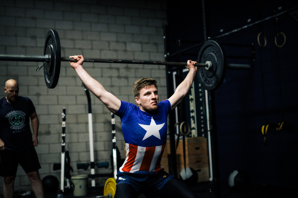 Christian S. pulling through hard on a power snatch in last week's workout.