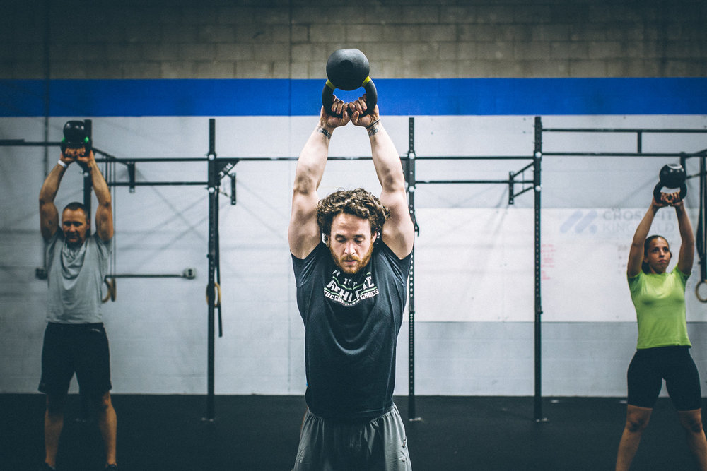 Danny warming up for class with some kettle bell swings.