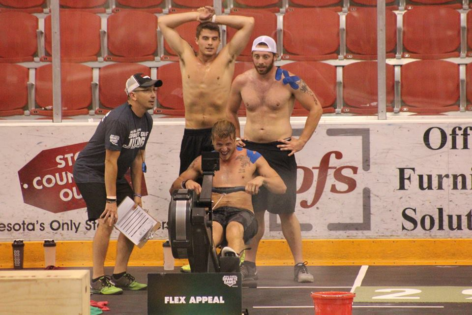 Teammates Matt and Alex watch over as Robert pushes hard during the last event of the 2015 Granite Games.