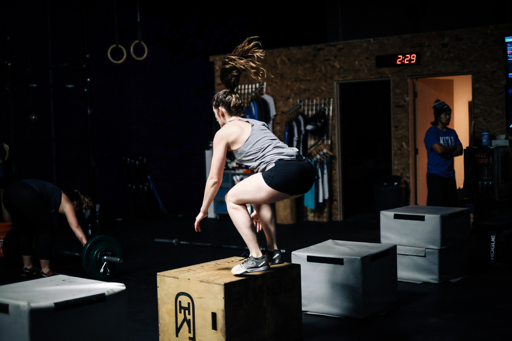 Mary S. sticking a box jump in a recent workout.