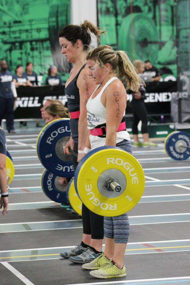Mariah O. and Clare D. standing up a heavy weight together during Granite Games 2015.