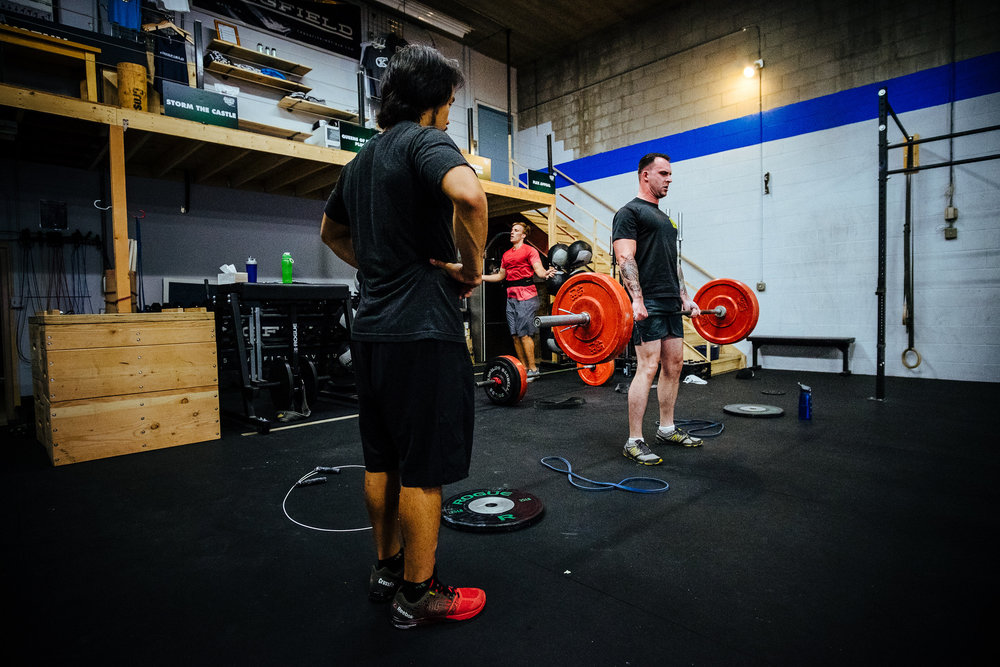Coach Chris keeping a close eye on good deadlift form.