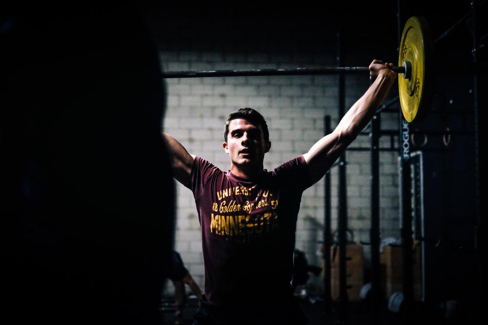 Matt G. breathing through a snatch rep during a workout.