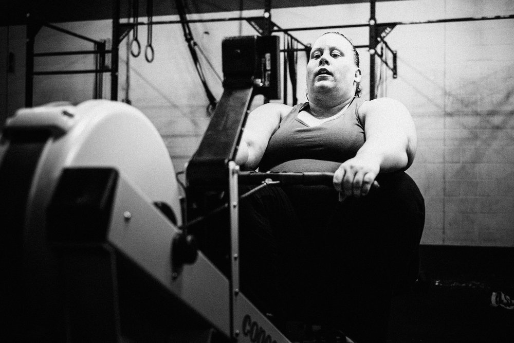Amy S. staying calm and focused during a brutal rowing WOD.