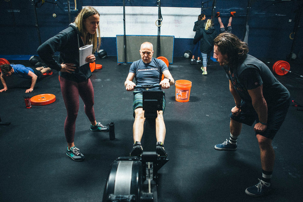 Danny & Amanda coaching Ron through tough row.