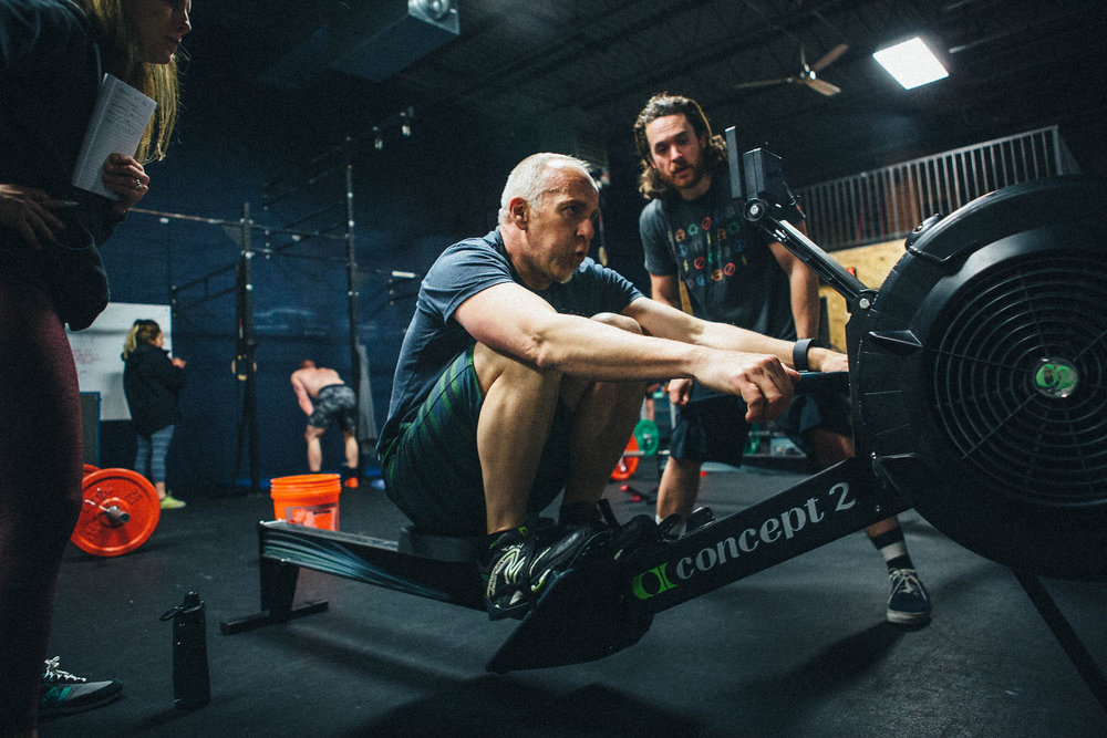 Ron B. pushing it on the rower as Coach Danny keeps him moving.