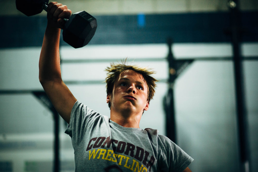 Cole J. working through DB snatches during a Kingfield Teens class over the summer.