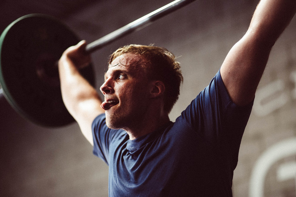 Hang in there. It's Friday! Zach F. hitting an overhead squat in a workout this summer.