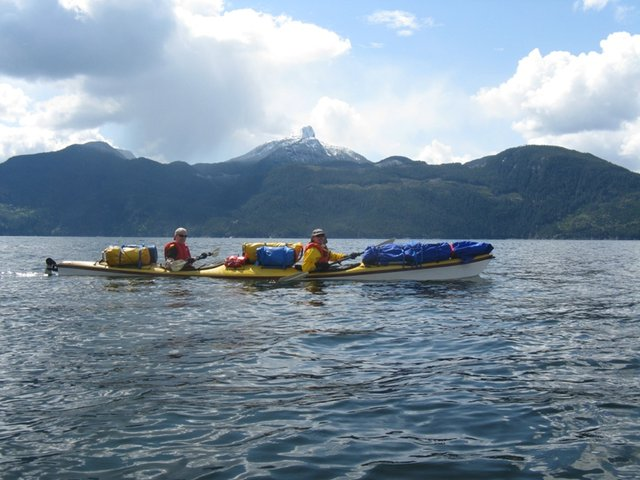Sea kayaking to access some of the remote peaks in the Coast Mountains. Photo Nick Matwyuk.