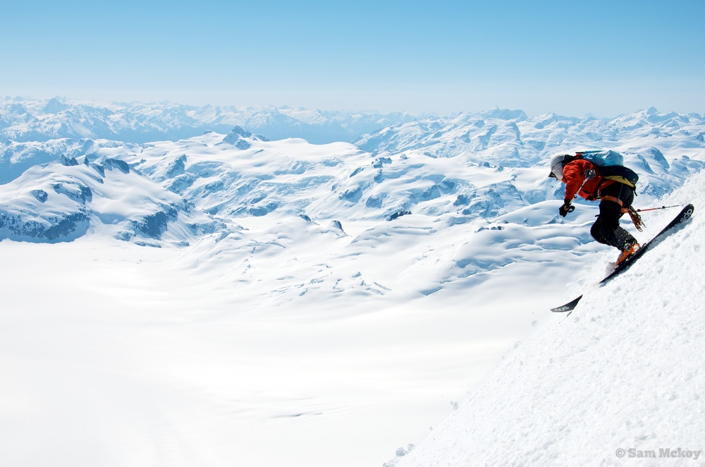 Nic Gobin skiing down from Silverthrone, our distant route in the background.