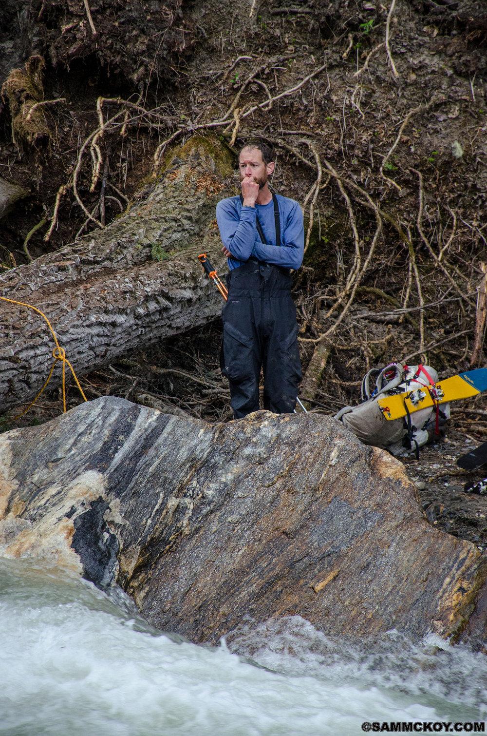 Mark observing as Madeleine cross the log.