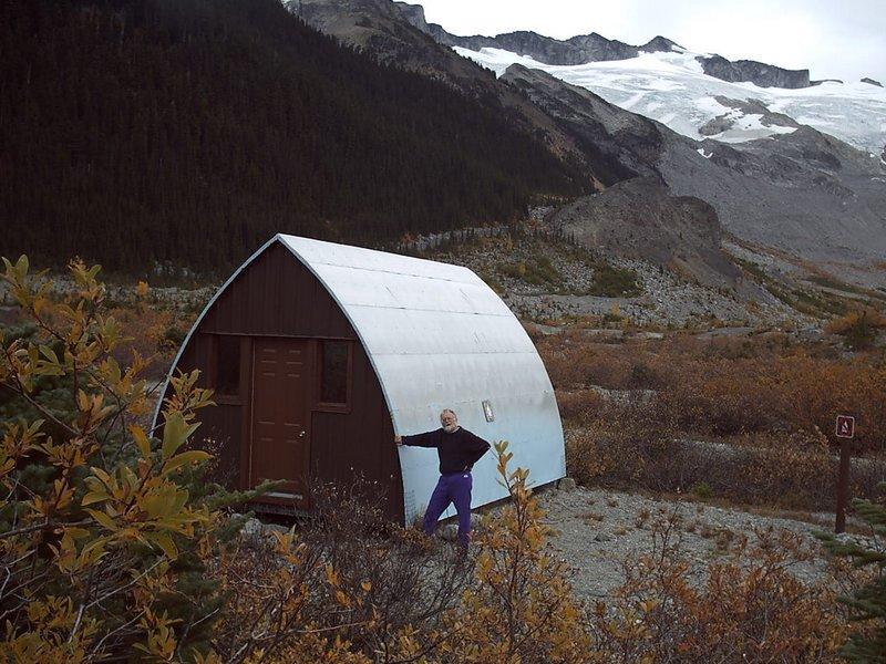 Roland Burton with his namesake hut during a fall renovation. Photo Christian Veenstra