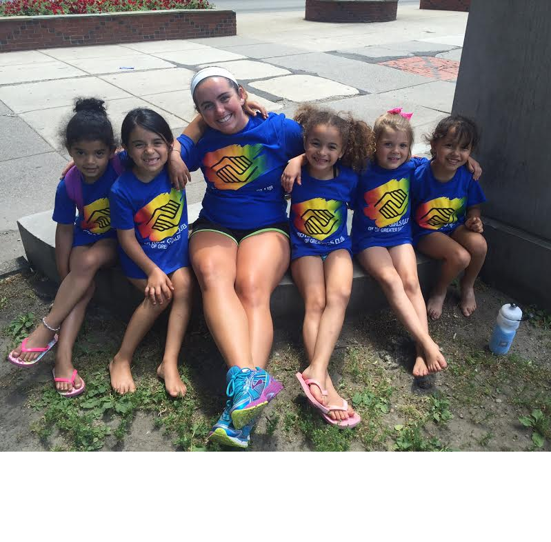 Camp Counselor Breanna with campers at the Boston Commons