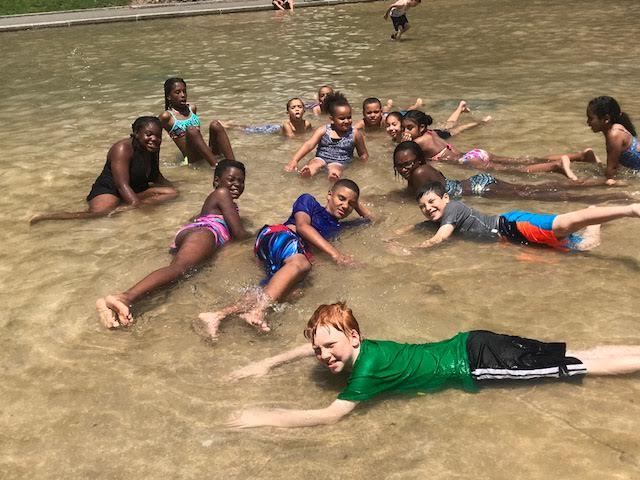 Campers enjoying frog pond